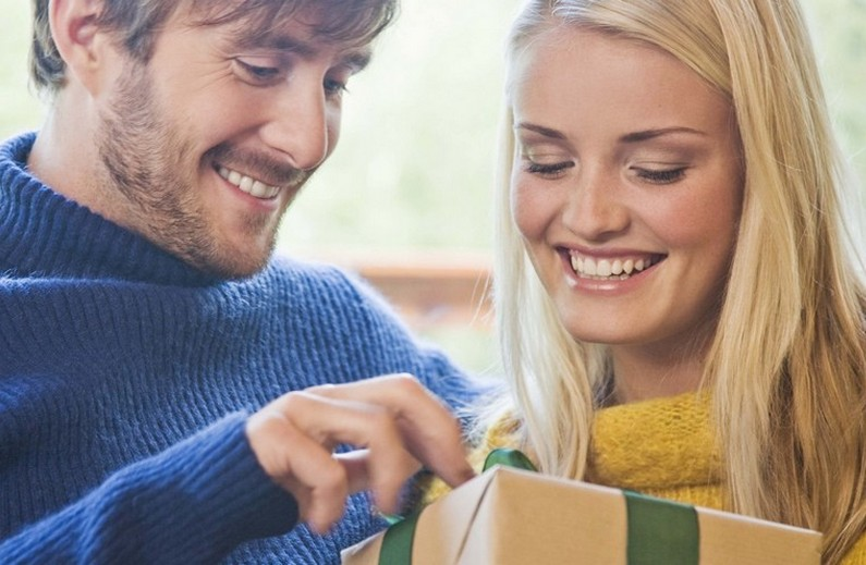 Couple holding wrapped present